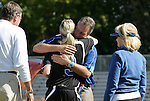 26 October 2008: Duke's Sheila Kramer (3) is hugged by head coach Robbie Church during Senior Day festivities. The Duke University Blue Devils defeated the Clemson University Tigers 6-0 at Koskinen Stadium in Durham, North Carolina in an NCAA Division I Women's college soccer game.