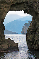 Futo Beach sea stack arch nicely frames the rugged landscape of the Dogashima coast on the Izu Peninsula of Japan