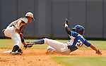 """Major League Baseball prospect Valerio Allen slides in safely during the final game of the """"Torneo Supremo"""" at the Quiskeya National Stadium in Santo Domingo. The Tournament which aims to maximize the ability of Major League Baseball organizations to scout in the Dominican Republic. According to the MLB's office in the Dominican Republic, this year, the tournament introduced 23 new baseball prospects. July 29 2011. ViewPress/ Kena Betancur"""