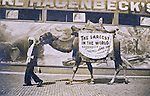 St Louis MO:  A view of man with a walking advertisement for the Carl Hagenbeck Circus of trained animals,  His attraction was one of the most popular at the St Louis Fair and also wherever he went.
