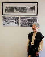 Mabel Jingu Enkoji, who lived in the house as a child, poses under photo prints hanging on the wall during the grand re-opening of the Jingu House, Saturday, Oct. 22, 2011, at the Japanese Tea Garden in San Antonio, Texas, USA. (Darren Abate/pressphotointl.com)