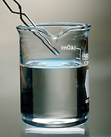 SUPERSATURATED SOLUTION - SODIUM ACETATE IN WATER: 2 of 6<br /> Tiny Seed Crystal Is Added<br /> The NaC2H3O2 will begin to recrystallize when a tiny seed crystal is added