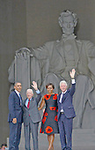 United States President Barack Obama, former U. S. President Jimmy Carter, first lady Michelle Obama, and former U.S. President Bill Clinton wave to the crowd following the Let Freedom Ring ceremony on the steps of the Lincoln Memorial to commemorate the 50th Anniversary of the March on Washington for Jobs and Freedom.<br /> Credit: Ron Sachs / CNP