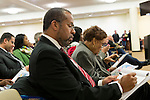 January 3, 2013 - Mineola, New York, U.S. - At front left, Attorney FREDERICK BREWINGTON, of Hempstead, and MARY A. ADAMS, are at the Nassau County Districting Advisory Commission's night time meeting on two Redistricting maps for the 19 Legislative Districts, one proposed by Republicans, one by Democrats. In the standing room only chambers, dozens shared their views with the commission during the Public Comment segment. After a brief recess, the commission voted at 10:40 PM for each map, neither of which passed. By January 5 it must complete its work for the Nassau Legislature, which must pass a Redistricting map by March 5, 2013.