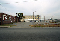 1991 October ..Conservation.MidTown Industrial..EXISTING BUSINESS.PRICE'S PARKING LOT.LOOKING NORTH FROM 18TH STREET...NEG#.NRHA#..