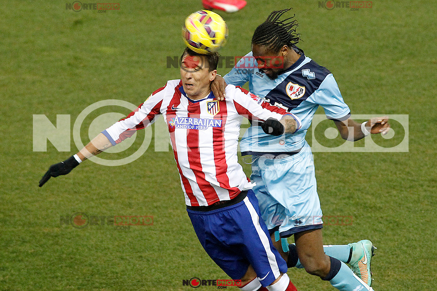 Atletico de Madrid's Mario Mandzukic (l) and Rayo Vallecano's Abdoulaye Ba during La Liga match.January 24,2015. (ALTERPHOTOS/Acero) /NortePhoto<br />