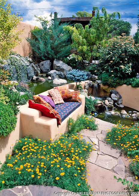 Susan Blevins of Taos, New Mexico, created an elaborate home garden featuring containers, perennial beds, a Japanese themed path and a regional style that reflects the Spanish and pueblo architecture of the area. Colorful pillows add a dash of pizaz to a sunken niche beside a waterfall.