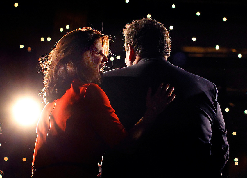 ASBURY PARK, NJ - (Nov. 15, 2013) -First Lady Mary Pat Christie puts her hand on the back of her husband, N.J. Gov. Chris Christie, as he delivers his victory speech at Convention Hall in Asbury Park after he easily won a second term as governor of New Jersey tonight, trouncing state Sen. Barbara Buono.