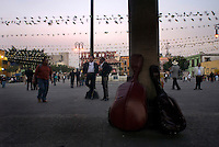 Mariachis and other musicians wait for night to arrive and buisness to start in Plaza Garibaldi where Mariachis gather to be hired in Mexico City, Friday, Jan. 4, 2008