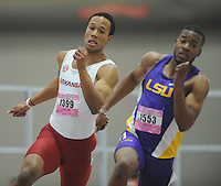 NWA Democrat-Gazette/ANDY SHUPE<br /> Arkansas junior Kenzo Cotton (1399) trails LSU senior Nethaneel Mitchell-Blake in the 200-meter invitational Saturday, Feb. 11, 2017, during the Tyson Invitational in the Randal Tyson Track Center in Fayetteville. Visit nwadg.com/photos to see more photographs from the meet.