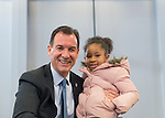 "Westbury, New York, USA. January 15, 2017.  Rep. THOMAS SUOZZI (Democrat - 3rd Congressional District) and SANAA SMITH, 5, of Westbury, pose for photo at end ofthe ""Our First Stand"" Rally against Republicans repealing the Affordable Care Act, ACA, taking millions of people off health insurance, making massive cuts to Medicaid, and defunding Planned Parenthood. Sanna attended rally with her mother Naima Smith, who actively advocates for health care. It was one of dozens of Bernie Sanders' rallies nationwide for health care that Sunday."