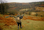 TeePee valley nr Llandeilo Wales. 1980s. Middle class drop out collecting timber. 120 people live here through out the year.<br />