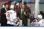 Sebastien Laplante (Northeastern - Assistant Coach), Garrett Vermeersch (Northeastern - 9), Greg Cronin (Northeastern - Head Coach), ? - The visiting Rensselaer Polytechnic Institute Engineers tied their host, the Northeastern University Huskies, 2-2 (OT) on Friday, October 15, 2010, at Matthews Arena in Boston, MA.