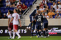 Davide Chiumiento (20) of the Vancouver Whitecap scelebrates scoring with teammates. The New York Red Bulls and the Vancouver Whitecaps played to a 1-1 tie during a Major League Soccer (MLS) match at Red Bull Arena in Harrison, NJ, on September 10, 2011.