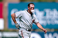 PHOENIX, AZ - Will Clark of the San Francisco Giants blows a bubble during a spring training game against the Oakland Athletics at Phoenix Municipal Stadium in Phoenix, Arizona in 1992. Photo by Brad Mangin