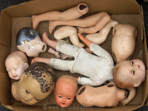 A box full of doll baby pieces at the Georgetown Flea Market, Washingon DC.