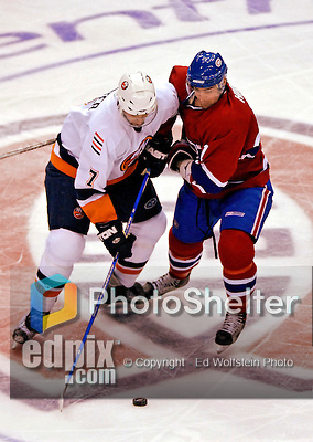 3 February 2007: Montreal Canadiens center Christopher Higgins (21) tries to take the puck away from New York Islanders right wing forward Trent Hunter (7) in the third period at the Bell Centre in Montreal, Canada. The Islanders defeated the Canadiens 4-2.