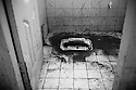 A dirty latrine in a school building used to house families affected by the floods. Hygiene is one of the biggest problems in the differernt camps and a big cause of diseases and infections among the IDP's. Karachi, Pakistan, 2010