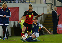 20170411 - LEUVEN ,  BELGIUM : Belgian Janice Cayman  pictured in a duel with Scottish Nicola Docherty (r) during the friendly female soccer game between the Belgian Red Flames and Scotland , a friendly game in the preparation for the European Championship in The Netherlands 2017  , Tuesday 11 th April 2017 at Stadion Den Dreef  in Leuven , Belgium. PHOTO SPORTPIX.BE   DAVID CATRY