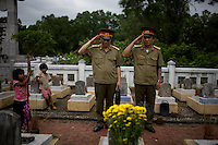 Vietnamese soldiers pay their respects to North Vietnamese soldiers who were killed during the Vietnam-American War at the Truong Son Cemetery in Quang Tri, Vietnam.
