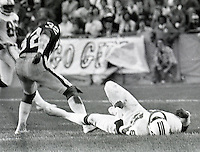 Patroit receiver Darryl Stingley on the ground after hit by Raider's Jack Tatum  in 1978 pre-season game in Oakland..(photo copyright 1978 Ron Riesterer/Oakland Tribune)