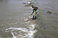 A fisherman drags up his fishing net. Thousands of people were displaced in Shyamnagar Upazila, Satkhira district after Cyclone Aila struck Bangladesh on 25/05/2009, triggering tidal surges and floods..