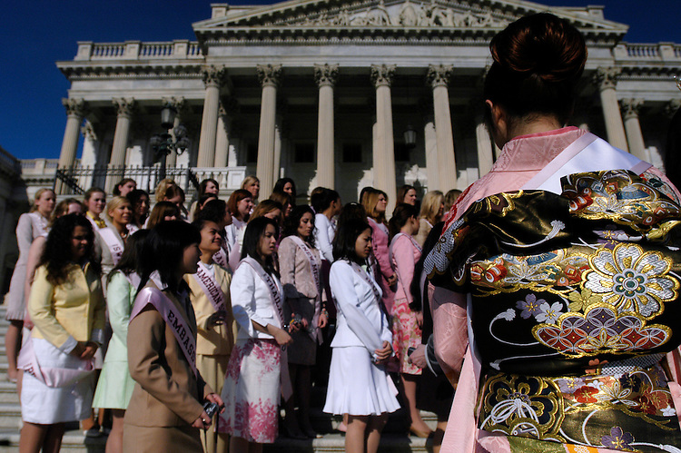 """Reina Mochizuki, the 2005 Japanese  """"Cherry Blossom"""" Princess, waits to pose for a picture with other princesses on the East Front of the U.S. Capitol."""