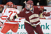 Ross Gaudet (BU - 22), Bill Arnold (BC - 24) - The visiting Boston College Eagles defeated the Boston University Terriers 3-2 to sweep their Hockey East series on Friday, January 21, 2011, at Agganis Arena in Boston, Massachusetts.