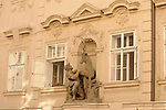 A building with a statue of a man and a deer in Prague, Czech Republic.