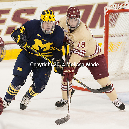 Evan Allen (Michigan - 15), Ryan Fitzgerald (BC - 19) - The Boston College Eagles defeated the visiting University of Michigan Wolverines 5-1 (EN) on Saturday, December 13, 2014, at Kelley Rink in Conte Forum in Chestnut Hill, Massachusetts.