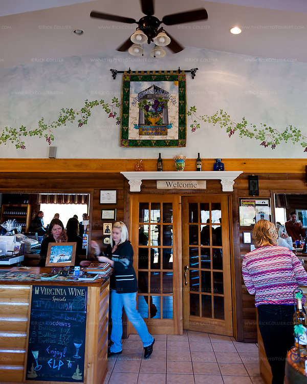 A tapestry with the winery's crest hangs on the back wall in Mediterranean Cellars' tasting room.  A central glass door to one side of the sales counter in the tasting room leads to an attractive events and dining room beyond.