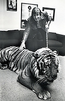 Golden State Warrior Executive Scotty Sterling with a tiger in his office. (1977 photo by Ron Riesterer)