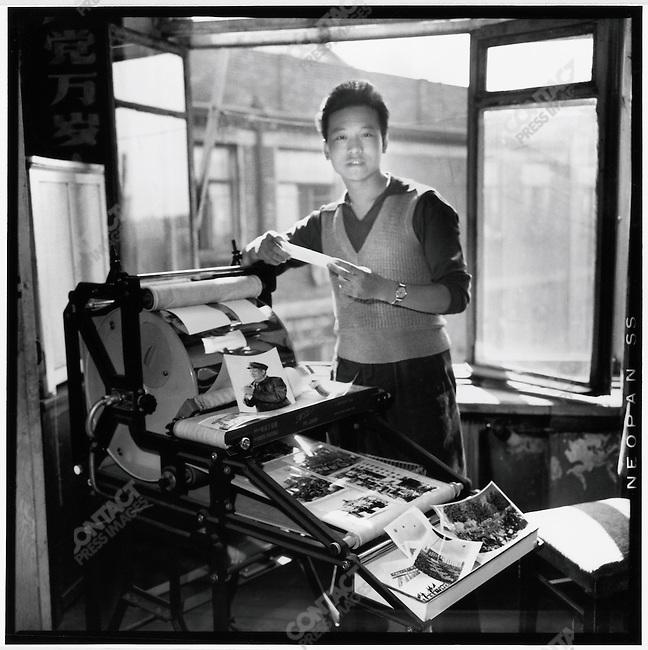 Li Zhensheng dries his own prints in the photography department of the Heilongjiang Daily; photograph by Wan Jiyao; Harbin, Heilongjiang Province, September 15, 1968