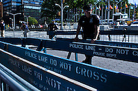 A NYPD officer stands guard near the U.N. headquarters while Iranian people take part in a protest against U.N. in New York,  Sept 24, 2013, Photo by Stringer / VIEWpress.