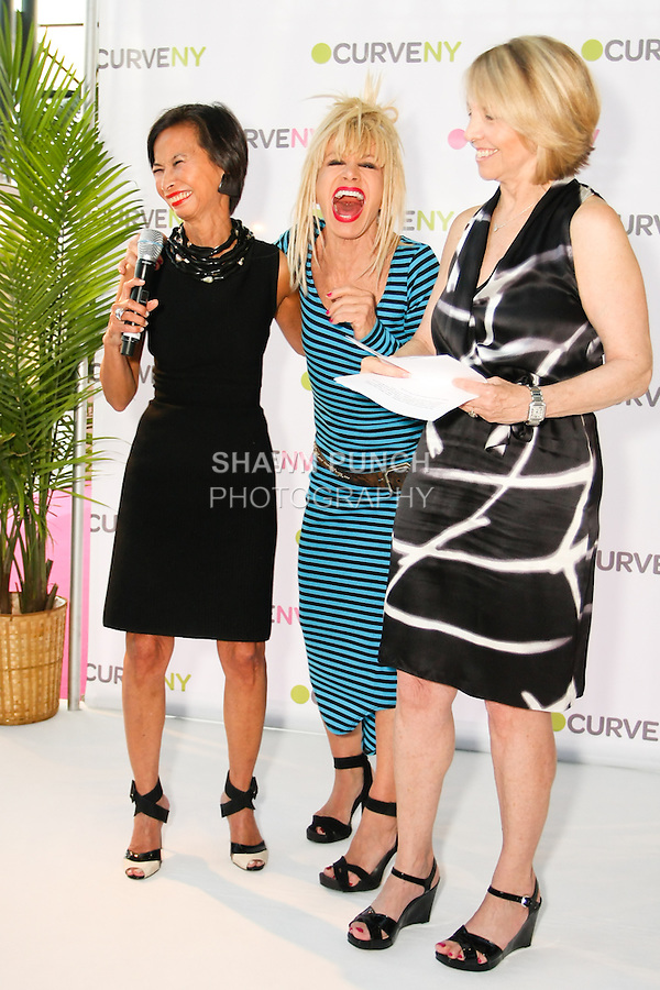 Josie Natori, Betsey Johnson, and Carole Hochman laughing on stage at the CURVE and CFDA Party For A Cause event during the CURVENY Lingerie & Swim show, at the Jacob Javits Convention Center, August 2, 2010.
