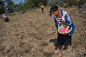 Black Hmong girl planting maize, Sapa, Vietnam