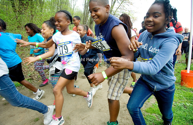 MIDDLEBURY CT. 09 May 2015-050915SV02-Runners take off in the first wave of the Xplorathon 2015 5k run/jog or walk at Hop Brook State Park in Middlebury Saturday.  The race was 3.1 mile long with obstacles that were mixed in throughout the trail. Proceeds of the event will benefit the children of the Waterbury Police Explorers. <br /> Steven Valenti Republican-American