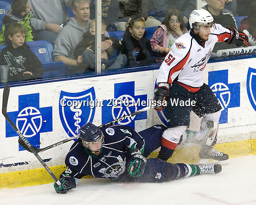 Tyler Brown (Plymouth - 12), Mark Cundari (Windsor - 51) - The Windsor Spitfires defeated the Plymouth Whalers 3-2 (OT) to sweep the Ontario Hockey League Western Conference Semi-Finals on Wednesday, April 7, 2010, at Compuware Arena in Plymouth, Michigan.