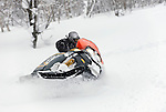 Resort staff lead the way during a snowmobile tour at Hanazono resort in Niseko, northern Japan on Feb. 6 2010. In addition to 57 runs, 38 lifts and gondolas and 47 km in groomed slopes, Niseko offers first timer slopes, half-pipes, quarter pipes, table tops, mogul fields and tree runs.