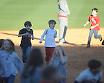 Jackson Newman and other kids run the bases following Ole Miss vs. Rhode Island at Oxford-University Stadium in Oxford, Miss. on Sunday, February 24, 2013. Ole Miss won 5-3 to improve to 7-0.