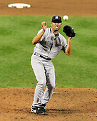 New York Yankees pitcher Mariano Rivera (42) tries to field a a ball off the bat of Baltimore Oriole designated hitter Vladimir Guerrero in the ninth inning at Oriole Park at Camden Yards in Baltimore, Maryland on Monday, August 29, 2011.  The Yankees won the game 3 - 2..Credit: Ron Sachs / CNP.(RESTRICTION: NO New York or New Jersey Newspapers or newspapers within a 75 mile radius of New York City)