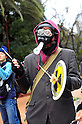 Tokyo, Japan - March 11: A man with a black mask participated in a demonstration against nuclear power plants at Chiyoda, Tokyo, Japan on March 11, 2012. As this day was one year anniversary of Great East Japan Earthquake and Tsunami, there were many demonstrations held in the city.