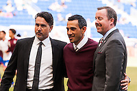 Colorado Rapids technical director Paul Bravo, head coach Pablo Mastroeni, and team president Tim Hinchey pose for a photo. The New York Red Bulls and the Colorado Rapids played to a 1-1 tie during a Major League Soccer (MLS) match at Red Bull Arena in Harrison, NJ, on March 15, 2014.