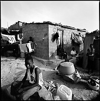 Luanda, Angola, May, 25, 2006.Bairro Muro do Boy; this slum is built on a hill of garbage, there is no water source in the area. Children have to go down the 'hill' and cross a newly built highway to bring back water for their family. Between February and June 2006, more than 30000 people were infected with cholera in Angola's worse outbreak ever; more than 1300 died.