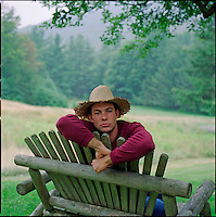Man wearing straw hat looking at camera