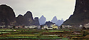 BB08324-00...CHINA - The town of Yangshuo situated on the banks of the Li River.