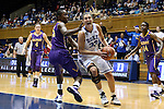 19 December 2013: Duke's Haley Peters (33) drives against Albany's Shereesha Richards (25). The Duke University Blue Devils played the University at Albany, The State University of New York Great Danes at Cameron Indoor Stadium in Durham, North Carolina in a 2013-14 NCAA Division I Women's Basketball game. Duke won the game 80-51.