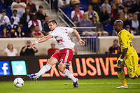 Kenny Cooper (33) of the New York Red Bulls shoots. The New York Red Bulls defeated the Columbus Crew 3-1 during a Major League Soccer (MLS) match at Red Bull Arena in Harrison, NJ, on September 15, 2012.