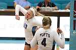 20120928 - Medford, Mass. - Tufts outside hitter/opposite hitter Kelly Brennan, A15, pumps her fist after driving home the match point in Tufts' 3-1 win over Connecticut College at Cousens Gymnasium on Sept. 28, 2012. (Kelvin Ma/Tufts University)