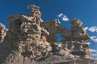 746000013 strange sandstone formations stand watch over the landscape in fantasy canyon a blm property in the middle of a working oil field in northeastern utah united states